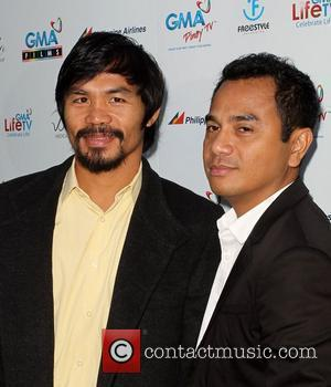 Manny Pacquiao and Yam Laranas