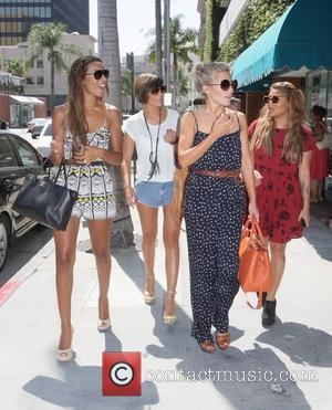 Frankie Sandford, Mollie King, Rochelle Wiseman and Vanessa White, of The Saturday's  get manicures at a salon in Beverly...