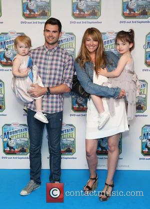 James Anderson with his wife and children Thomas & Friends Blue Mountain Mystery premiere held at the Vue cinema -...
