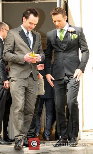 Harry Judd and Guest The wedding of McFly's Tom Fletcher and Giovanna Falcone in Marylebone London, England - 12.05.12