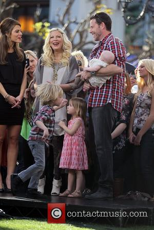 Tori Spelling and Dean McDermott along with their children Stella, Liam and Hattie McDermott appear on 'Extra' at The Grove...