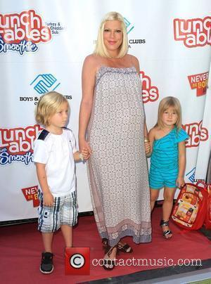 Tori Spelling Recovering From Emergency Surgery