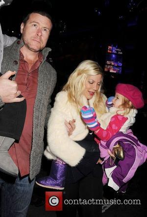 Dean McDermott, Tori Spelling, family  Disney On Ice presents Disney Pixar's Toy Story 3 - Arrivals at Nokia Plaza...