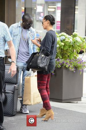 Actress Tracee Ellis Ross and Akon's little brother Bu Thiam  exit their SoHo Hotel and share a goodbye kiss....