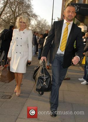 Kristina Rihanoff and Robert Windsor  The TRIC Awards held at the Grosvenor House - Departures London, England - 13.03.12