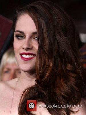 PICTURES: Twilight Saga: Breaking Dawn Part 2 Premiere Sees Robert Pattinson And Kristen Stewart Reunite