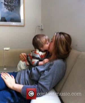Actress Alicia Silverstone posted an image of herself feeding her baby son by chewing food and passing it to him...