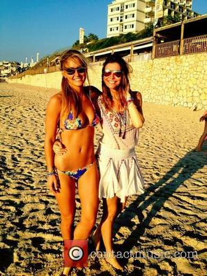 Bar Refaeli posted this image of her and her sister on Twitter with the caption 'With my live, my sister,...