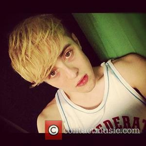 Jedward posted this image to Instagram with the caption '911 we got an emergency! Jedward are wearing vests not shirts!...