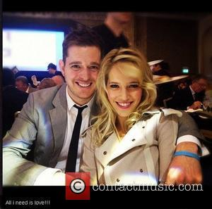 Luisana Lopilato tweets this pic of herself and husband Michael Buble with the caption, 'All i need is love!!!' 30.06.12...