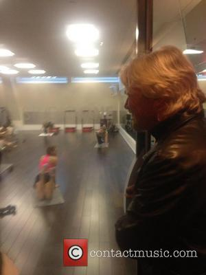 Sir Richard Branson posted this image on Twitter with the caption 'At @virginactiveuk. Cancel my appointments, may stay here all...