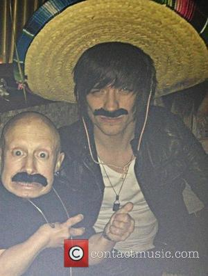 Verne Troyer tweets this pic with the following caption, 'Mustache? Hangin with @BoyEpic last night' 06.05.12 Supplied by...