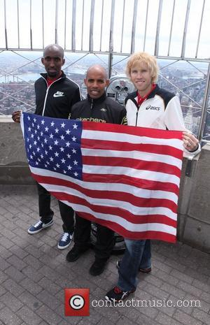 Abdi Abdirahman, Meb Keflezigi and Ryan Hall of the Men's U.S. Olympic Marathon Team visit the Empire State Building on...