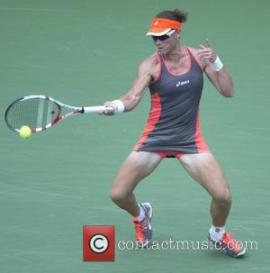 Samantha Stosur (AUS) resumes her battle with Victoria Azarenka (BEL) after a rain delay at the US Open being held...
