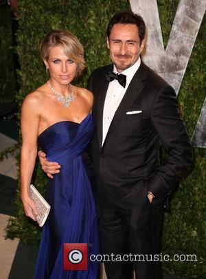Demian Bichir (R) and Stefanie Sherk 2012 Vanity Fair Oscar Party at Sunset Tower Hotel - Arrivals West Hollywood, California...