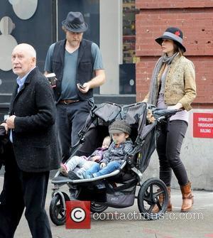 Renn Hawkey, Vera Farmiga, Gytta Lubov Hawkey and Fynn Hawkey Vera Farmiga pushing her children in a stroller while out...