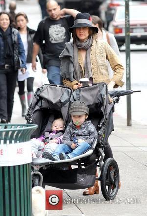 Vera Farmiga, Gytta Lubov Hawkey and Fynn Hawkey Vera Farmiga pushing her children in a stroller while out and about...
