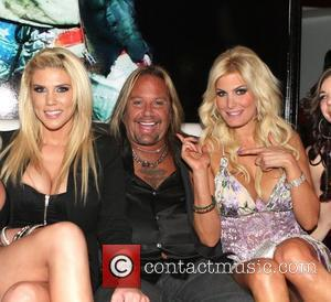 Vince Neil and Rain Andreani with guest Vince Neil's Girls, Girls, Girls club grand opening Las Vegas, Nevada - 13.04.12