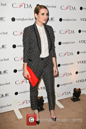 Emma Roberts Accidentally Doused In Champagne At Publicity Event