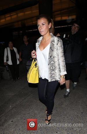 Coleen Rooney arrives at LAX on a flight from London Los Angeles, California - 26.06.12