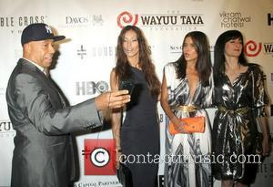 Russell Simmons, Dayana Mendoza and Patricia Velasquez