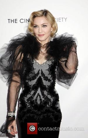 Madonna Has Her 'Fingers Crossed' For W.e. At Oscars