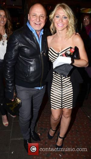 Aldo Zilli and Laura Hamilton at the 'We Will Rock You' 10th year anniversary performance at the Dominion Theatre -...