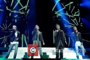 (LtoR) Kian Egan, Shane Filan, Mark Feehily and Nicky Byrne of Westlife perform on stage at the 02 Arena. London,...