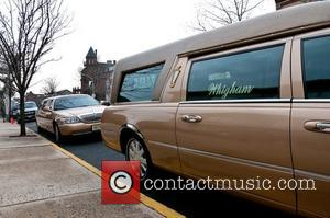 The hearse which carried Whitney houston's body to Whigham Funeral Home Newark, New Jersey - 15.02.12