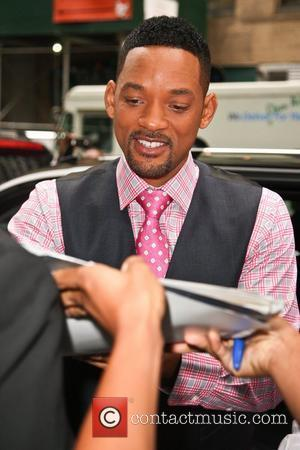 Will Smith signs autographs for fans as he leaves his hotel in Midtown Manhattan. New York City, USA - 24.05.12