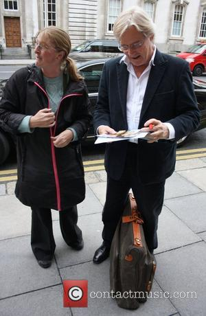 William Roache greets a fan as he arrives at his hotel ahead of his appearance on 'The Saturday Night Show'...