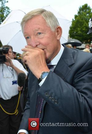 Sir Alex Ferguson  arriving for the 2012 Wimbledon men's final between Roger Federer (SWI) and Andy Murray (SCO) on...
