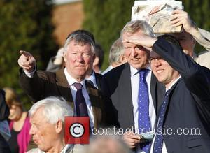Sir Alex Ferguson  watches his horse run at Winter Derby Day at Lingfield Park Racecourse  Surrey, England -...