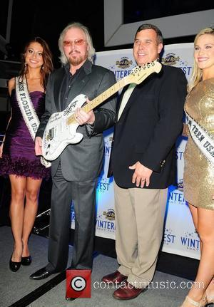 Karina Brez Miss Florida USA 2012, Barry Gibb and Phil Madow  2011 Winterfest Boat Parade VIP Party at the...