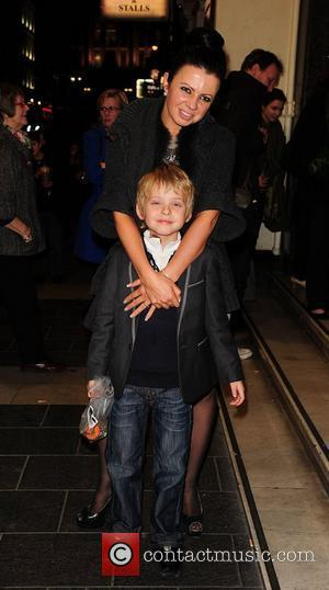 Karen Hardy and son  attending the The Wizard of Oz - media night at the London Palladium, London, England...
