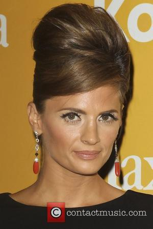 Stana Katic and Beverly Hilton Hotel
