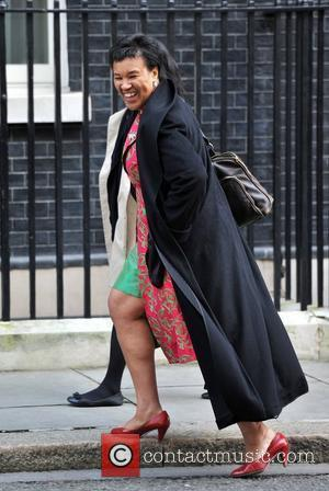 Baroness Patricia Scotland of Asthal (R)  arrives for a Women's Day reception held at 10 Downing Street. London, England...