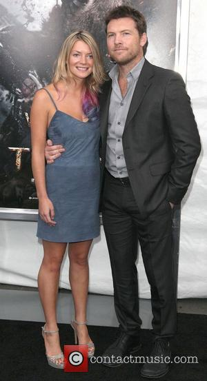 Crystal Humphries, Sam Worthington,  at the world premiere of 'Wrath of The Titans' at the AMC Lincoln Square IMAX...