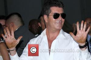 Are Simon Cowell and Carmen Electra An Item?