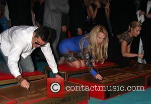 Simon Cowell, Britney Spears, Demi Lovato and X Factor