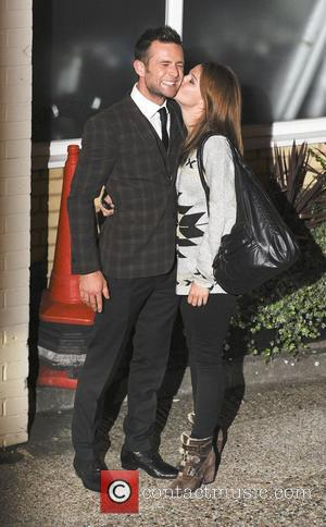 Harry Judd with Izzy Johnston,  at the X Factor held at Fountain Studios. London, England - 14.10.12