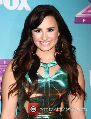 Demi Lovato Remembers Newtown School Massacre Victims At Christmas