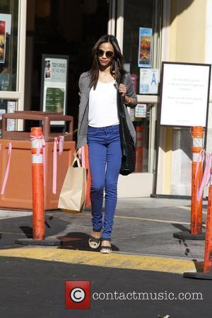Zoe Saldana Spotted 'Kissing' Bradley Cooper