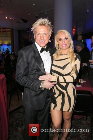 Chris Phillips and Coco Austin