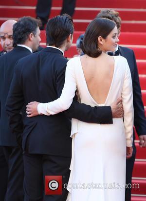Marion Cotillard and Jeremy Renner