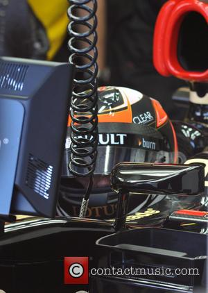 Kimi Raikkonen in his office and the cockpit of his Lotus Renault F1 car at the Australalian GP - Kimi...