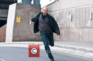 Jason Statham - Jason Statham playfully tries to grab a camera from the hands of a paparazzi photographer United Kingdom...