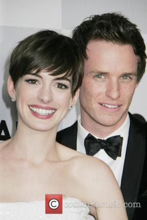 Anne Hathaway and Eddy Redmayne - NBC Universal's 70th Annual Golden Globe Awards After Party Los Angeles California United States...