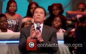 Arnold Schwarzenegger and Jaimie Alexander