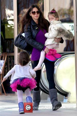 Oksana Grigorieva and Lucia Gibson - Oksana Grigorieva With Daughter Los Angeles California United States Saturday 19th January 2013